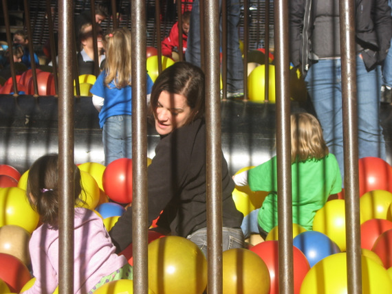 Playing in the ball and balloon cage