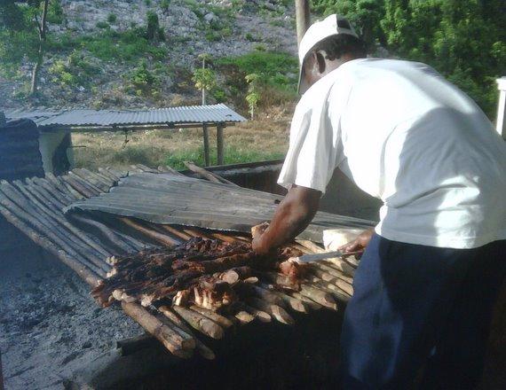 Preparing the meat at Boston Jerk Centre